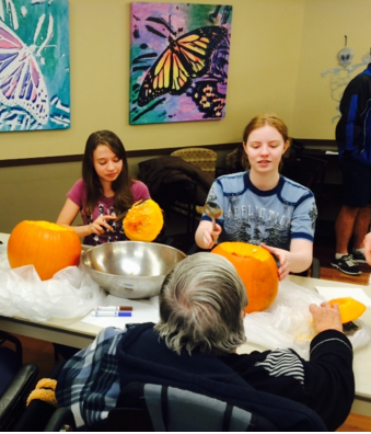 Carving Pumpkins at youville home