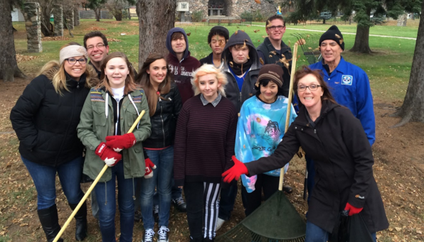 raking leaves on parish grounds to help Father Ignacy